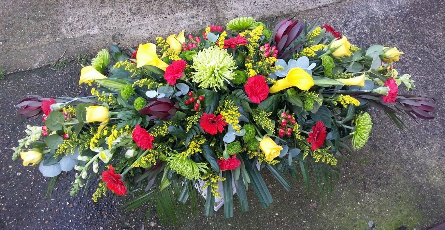 Red & Yellow Coffin Spray from £150.00