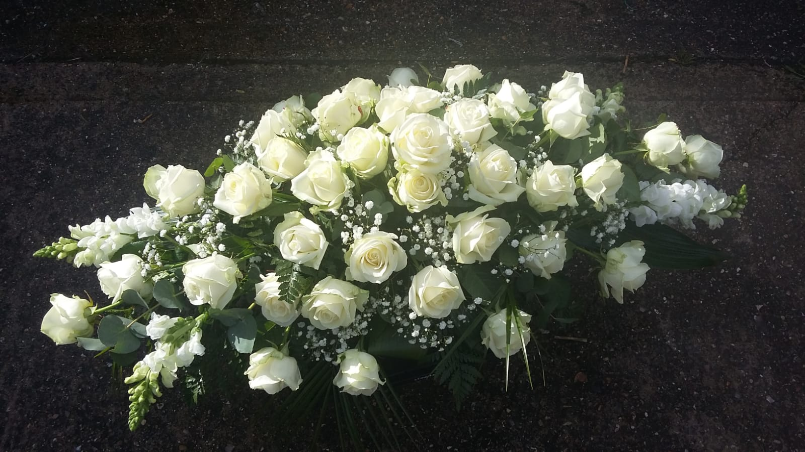 Cream Rose Coffin Spray from £150.00